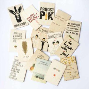 Houten kaarten met quotes en teksten