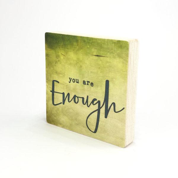 tekst op houten blok You are enough